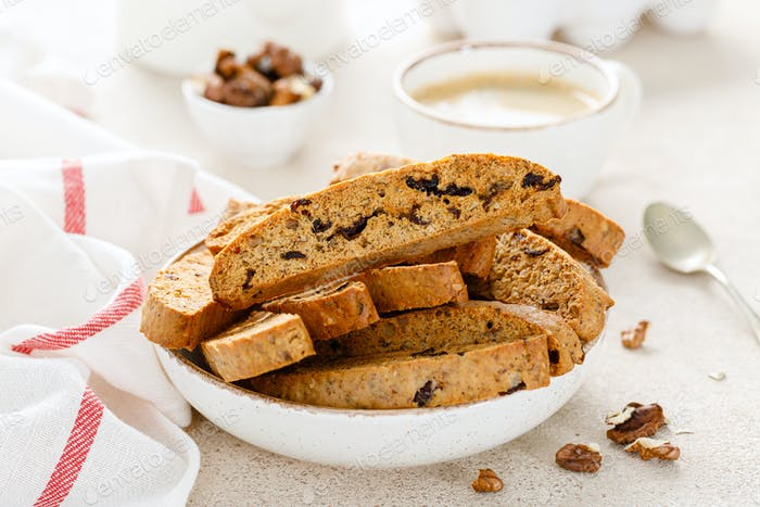 Biscotti cookies with dried cranberry, walnuts and with a cup of coffee