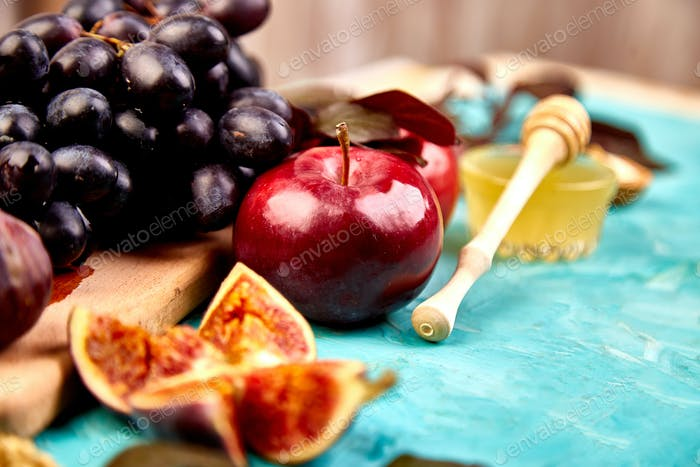 Autumn food still life with season fruits grape, red apples and figs.