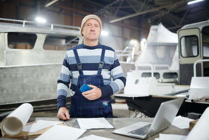 Mature engineer in shipyard