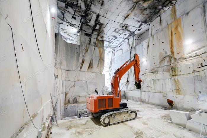Large excavator inside a Carrara marble quarry