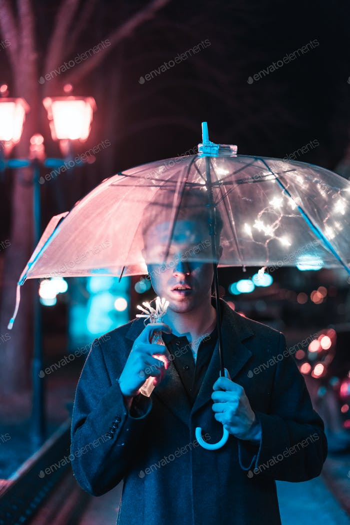 Guy under an umbrella