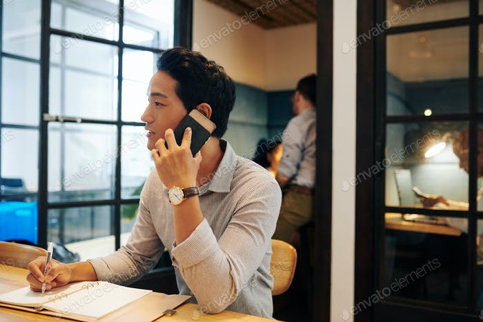 Young businessman calling on phone