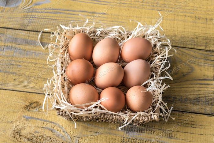 Basket of raw chicken eggs