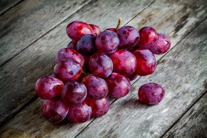 organic ripe grapes on wooden background