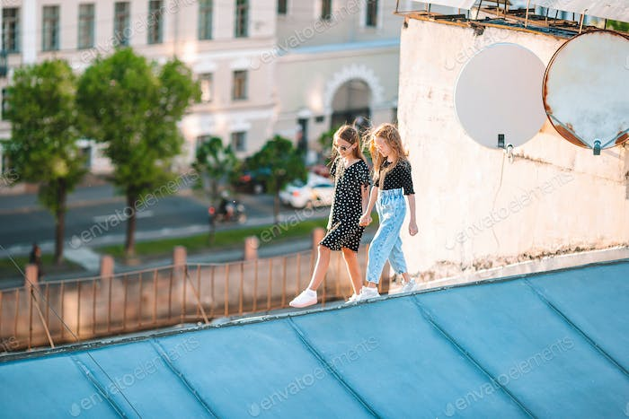 Cute girlson rooftop enjoying with view of beautiful sunset in Sankt Petersburg in Russia
