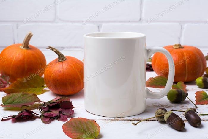 White coffee mug mockup with pumpkins, acorns