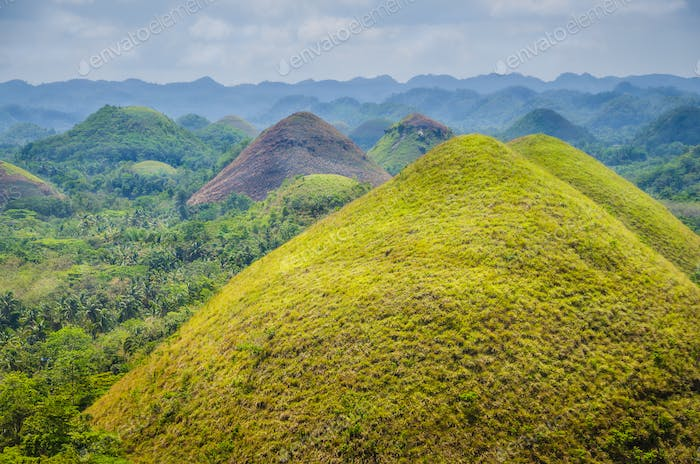 Chocolate hills in Bohol, some Clouds in Background, Philippines