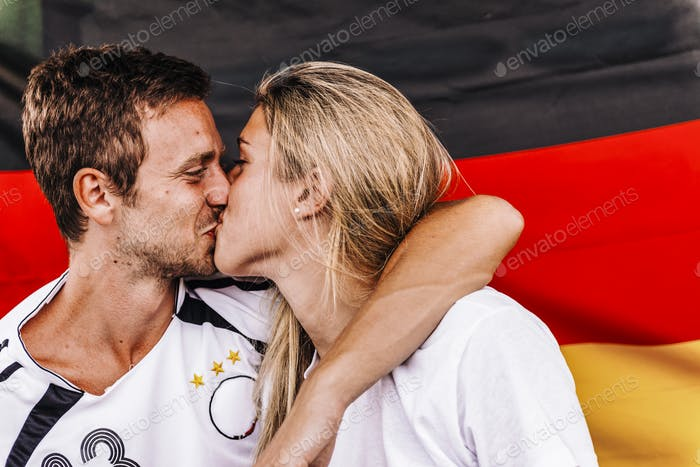 Supporters from Germany kissing at Stadium