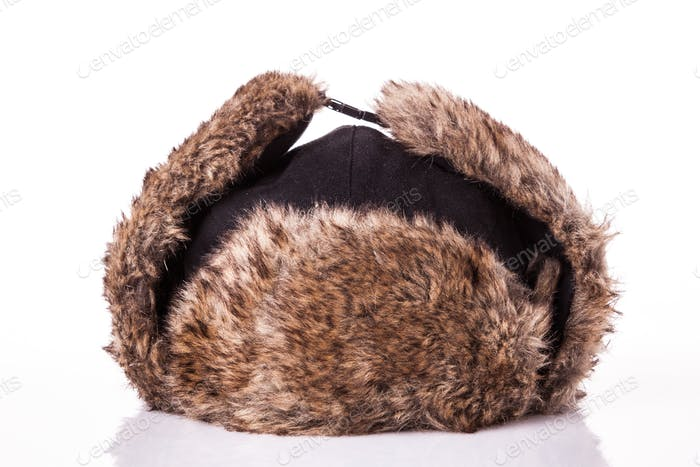 Fur cap for winter weather. Fur cap for winter isolated on white