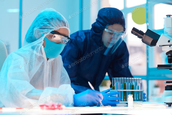 Workers Wearing Hazmat Suits in Laboratory