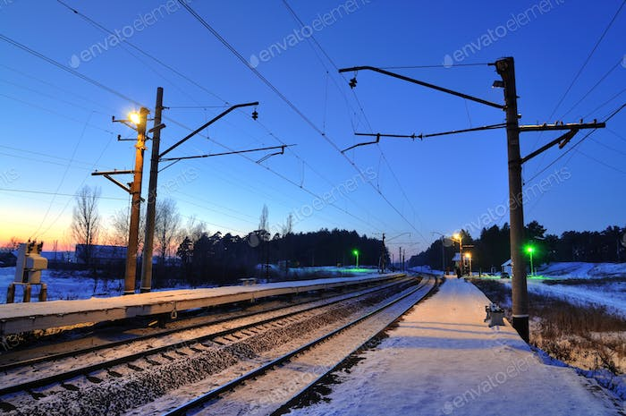 Evening winter landscape of the railway