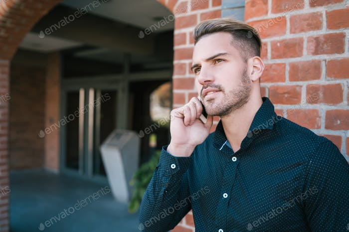 Man talking on the phone outdoors.