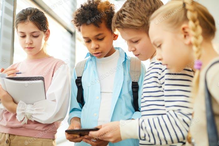 Children Watching Something In Internet