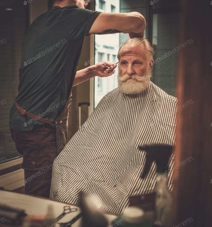 Thumbnail for Confident senior man visiting hairstylist in barber shop.