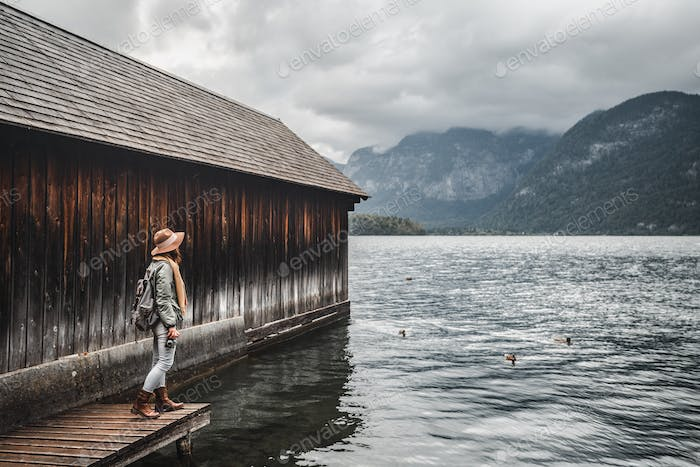 Young tourist on a wooden pier