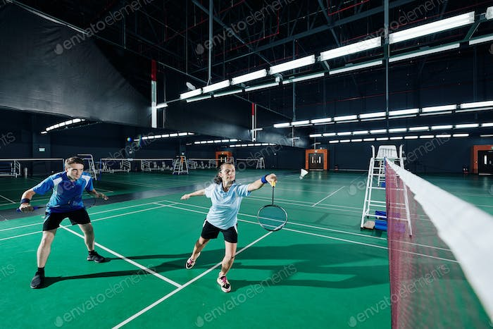Mixed double playing badminton