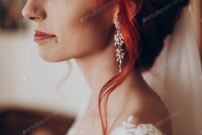 stylish bride detail, luxury earring and red hair curl