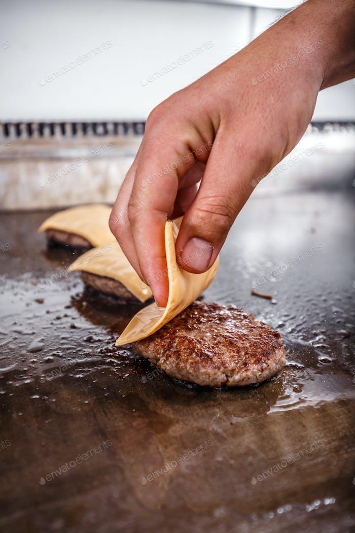 Chef prepar cheese burger patties