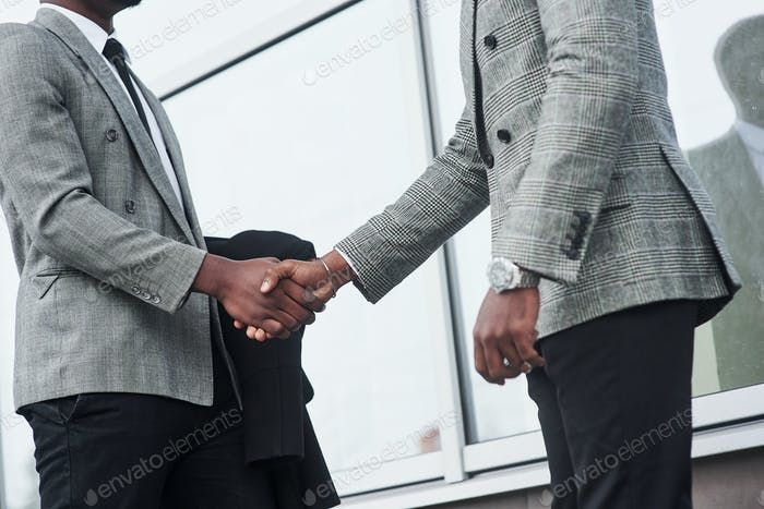 Successful African American business men after signing the contract