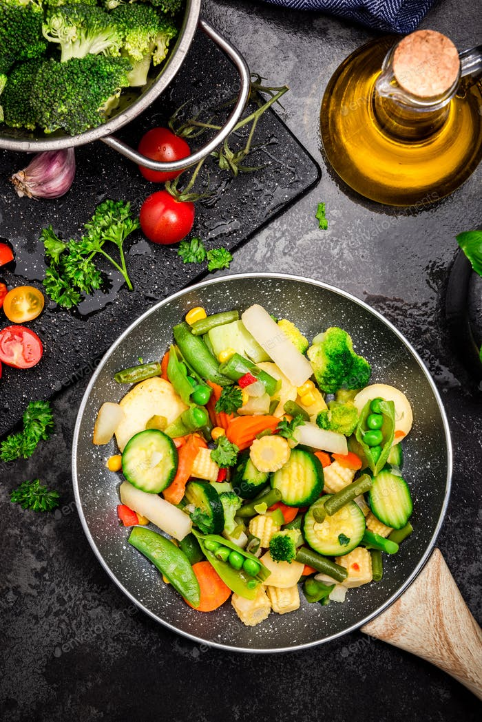 Stir Fry Vegetables on Pan. Healthy Eating and Dieting at Home. Dark Tones Image. Top Down View