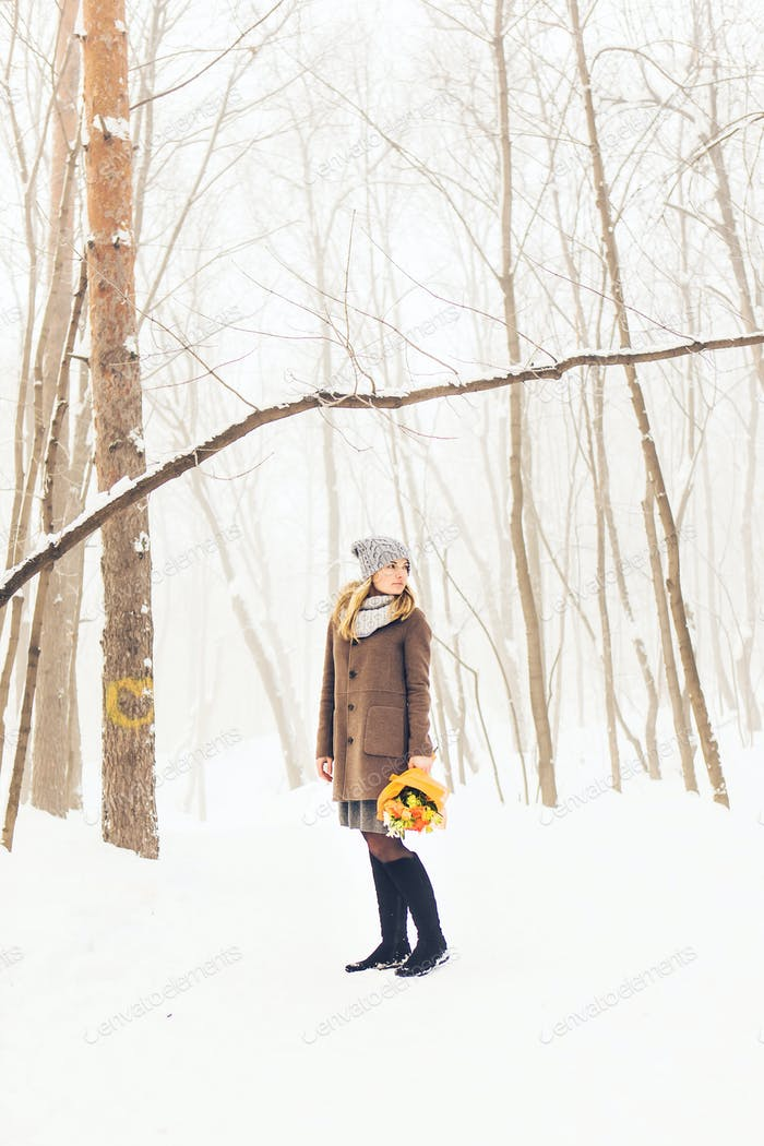 Attractive young girl in winter outdoor
