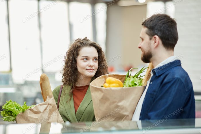 Adult Couple Shopping in Supermarket
