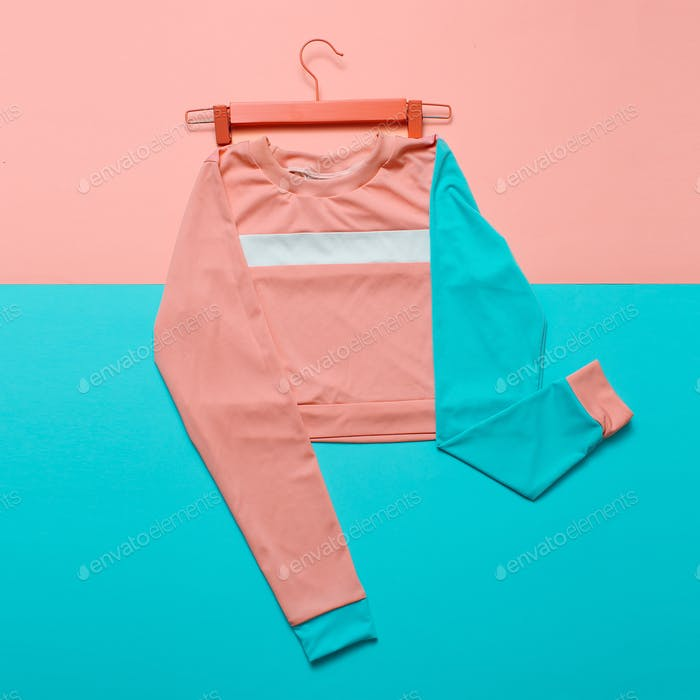 Stylish sports blouse on the hanger. Hipster style. Pastel color