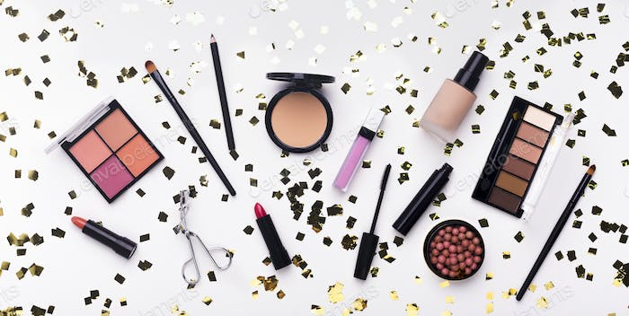 Flat lay of makeup products and accessory on white background