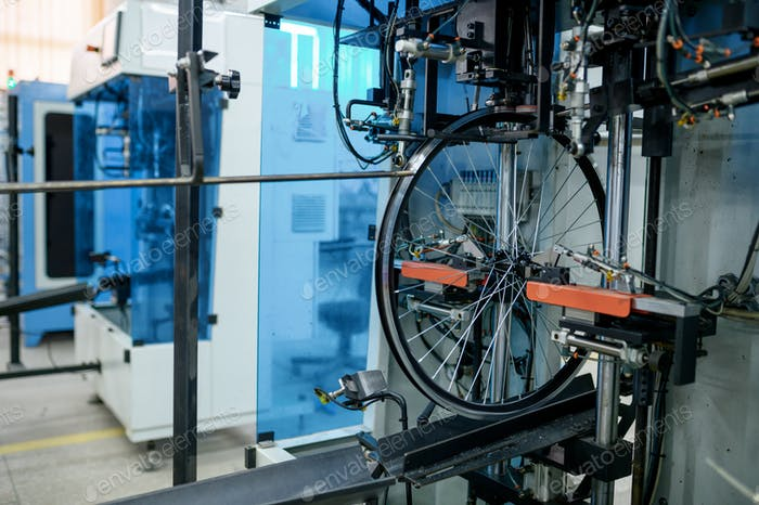 Bicycle wheels, assembly line, spokes installation