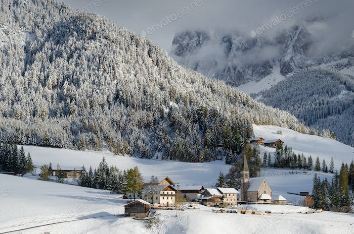 A mountain village in the winter snow