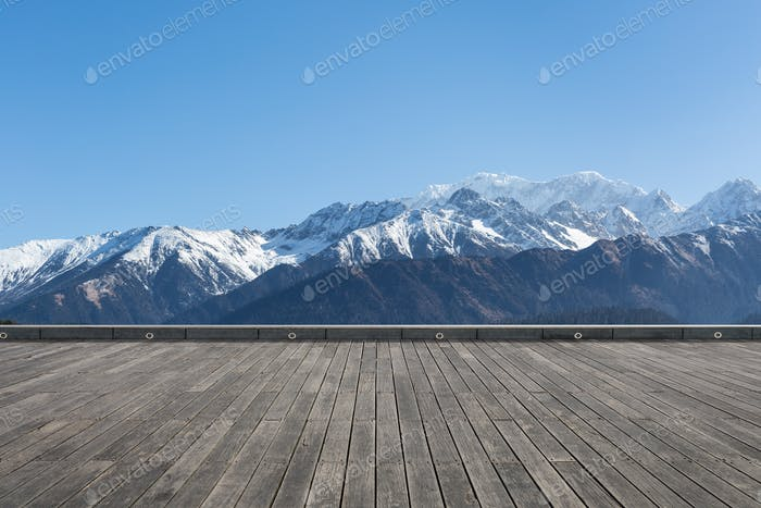 snow mountain with wooden floor