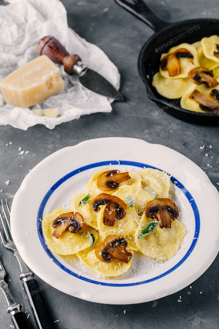 ravioli pasta with champignon mushrooms and parmesan cheese