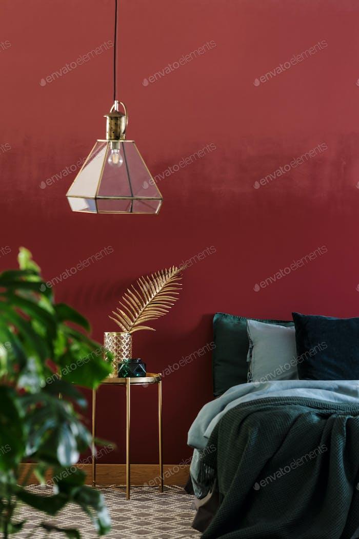 Lamp in maroon bedroom