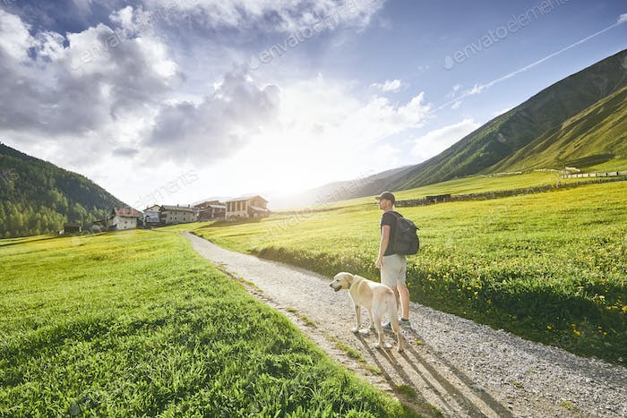 Tourist with dog in countryside