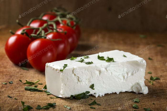 Feta cheese with bunch of cherry tomatoes