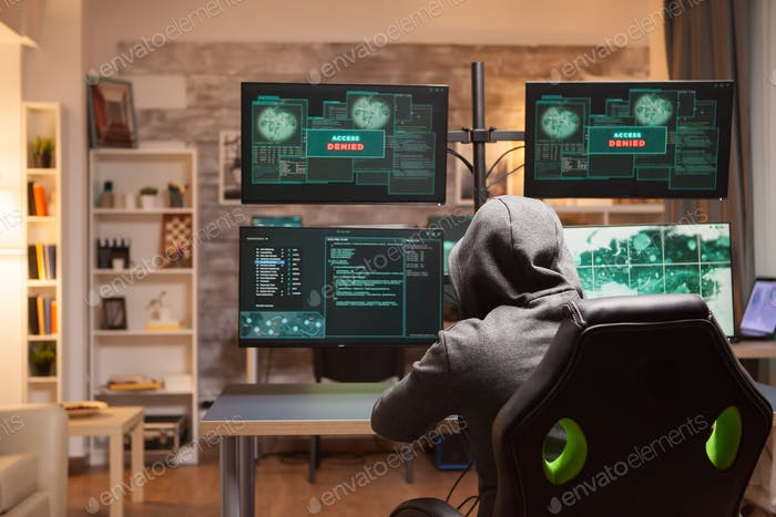 Access denied for male hacker wearing a hoodie