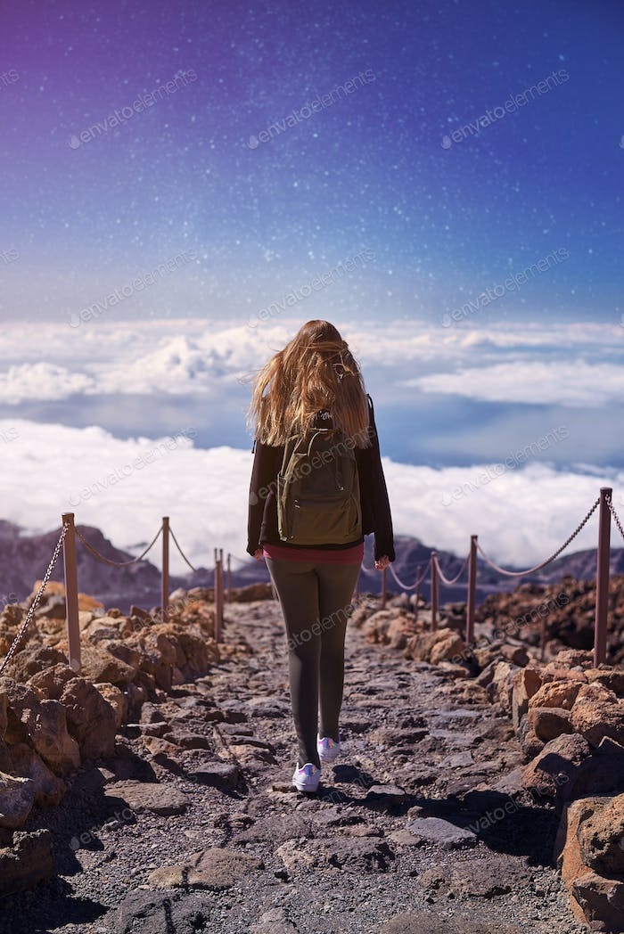 Young woman hiking the Teide Volcano in Tenerife, Canary Islands, Spain
