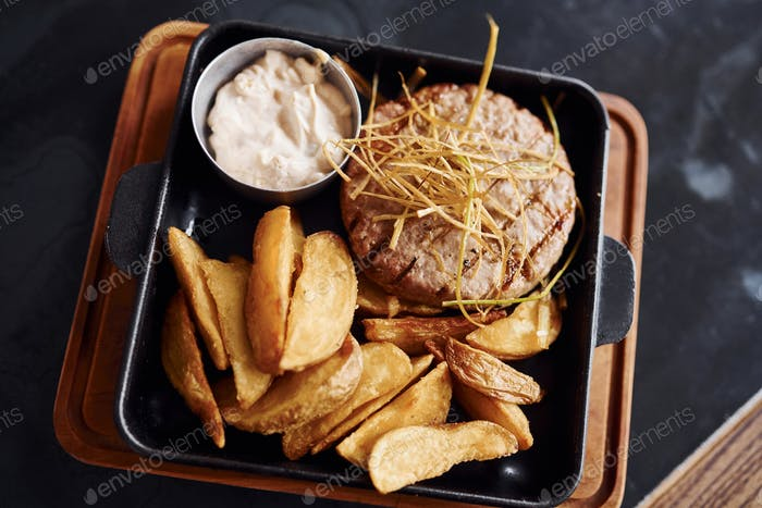 Top view of fresh fast food on the plate on table of restaurant