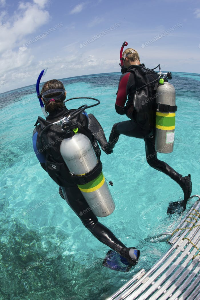 Demonstration of the Giant stride water entry, used by both snorkelers and divers,Scuba divers