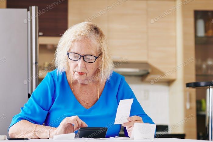 Senior woman handles bookkeeping