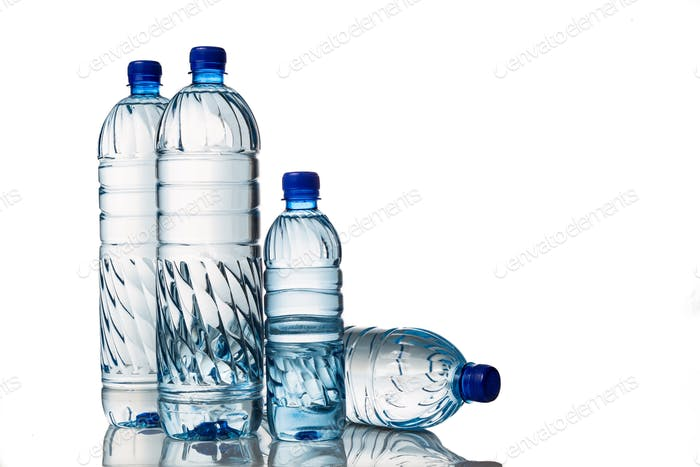 Four refreshing mineral water in plastic bottle in white backgro