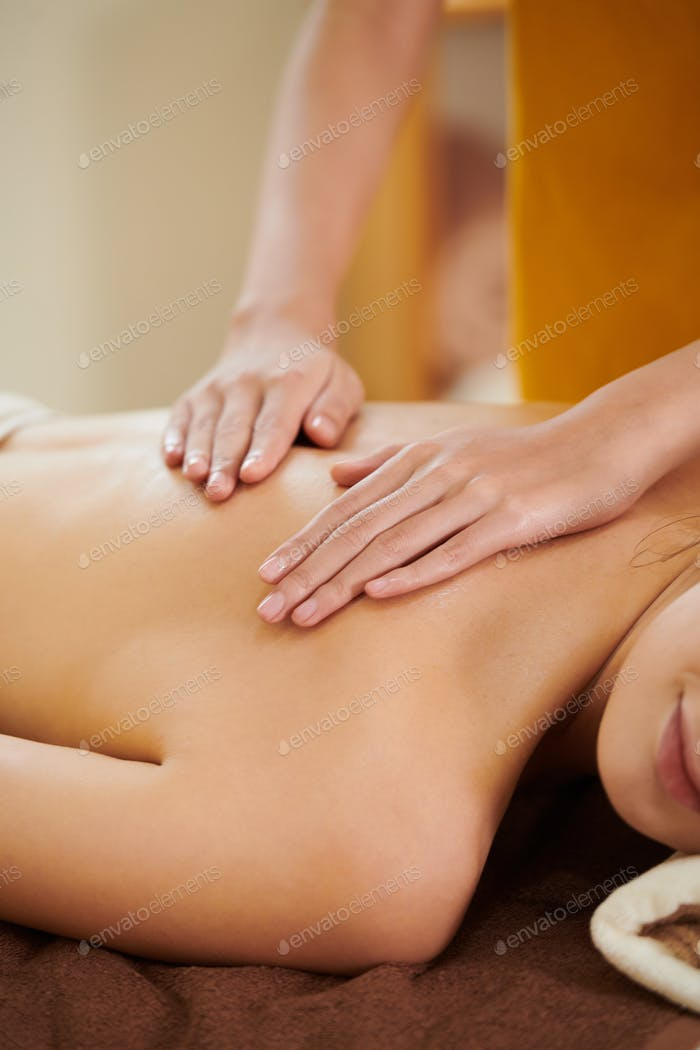 Girl getting massage in spa