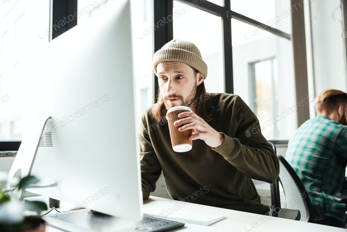 Handsome man in office using computer