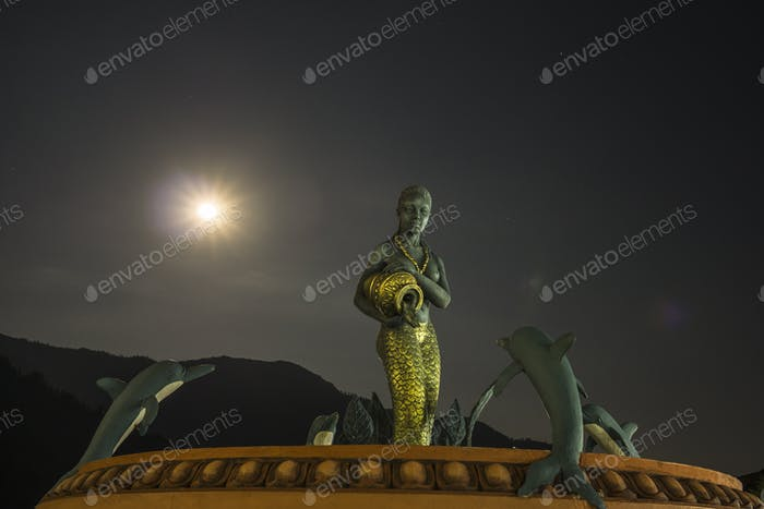 Fountain statue outside Gateway Himalaya Resort in Besisahar at night