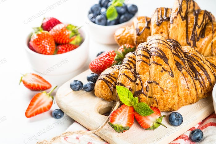 Croissant with chocolate and fresh berries