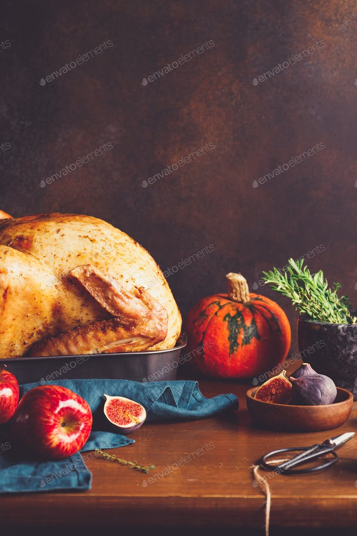 Festive table for Thanksgiving Holiday with whole roasted turkey