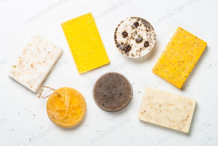 Natural soap bars on white top view