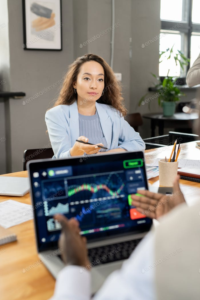 Confident businesswoman interacting with AFrican colleague