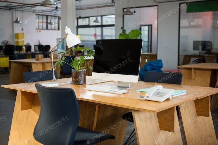 Personal computer and landline on desk