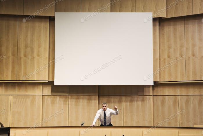 Politician making a speech at a political meeting.